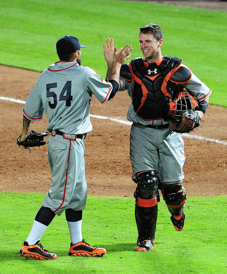 Sergio Romo and Buster Posey Photograph by Scott Cunningham