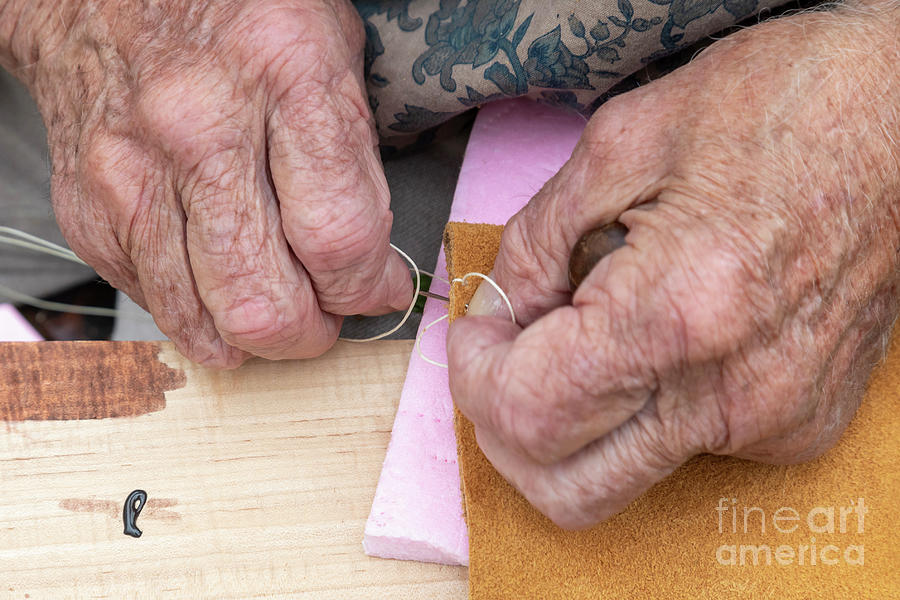 Moccasin Photograph - Sewing by Jim West