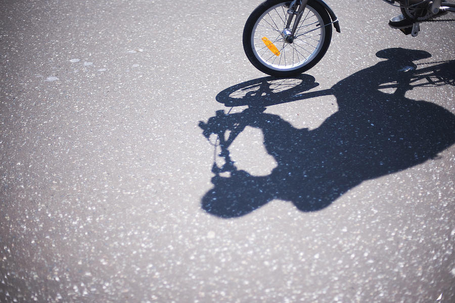 Shadow of cyclist on road Photograph by Lyn Holly Coorg