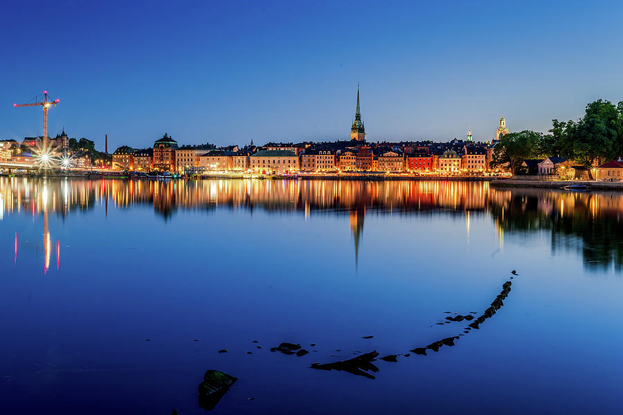 Stockholm Photograph - Shipwreck and Stockholm Gamla Stan fantastic reflection in the Baltic Sea by Dejan Kostic
