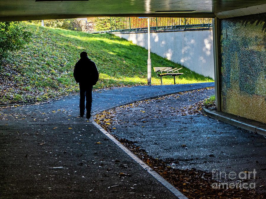 Silhouette of person in subway underpass by Richard Jemmett