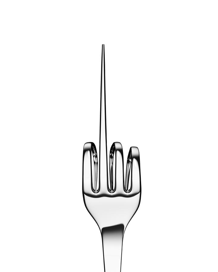 Silver fork bent to form hand sign on black Photograph by Atomic Imagery