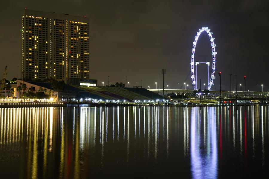 Singapore Flyer at night by Nathan Rupert