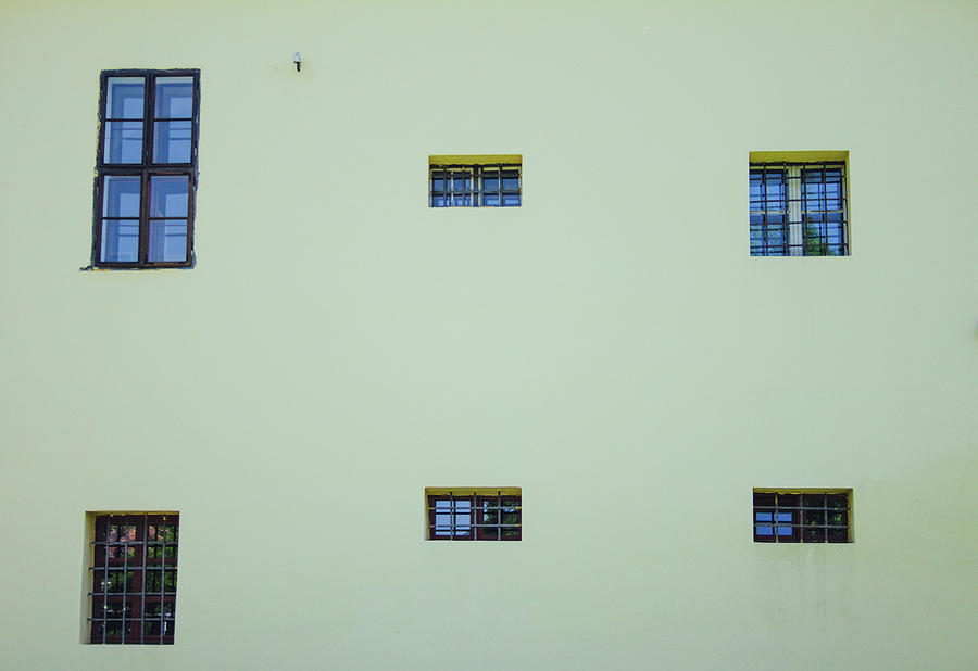 Six Windows On The Side Of A Building, All In Different Shapes Photograph
