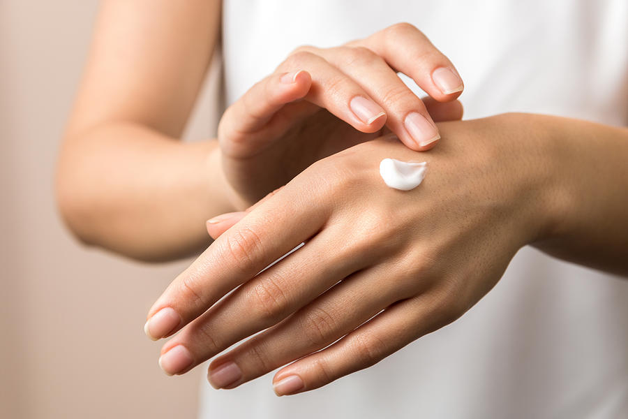 Skincare. Close Up View Of Woman Hand Moisturising Them With Cream. Skincare Photograph by AndreiDavid