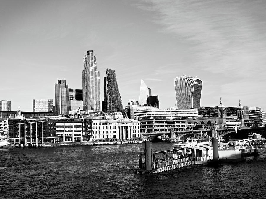 Skyscrapers of the City of London over the Thames , England in black and white by Santosh Puthran