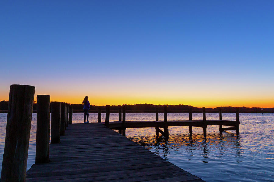 Slhouette Of Woman On Pier At Sunset Photograph