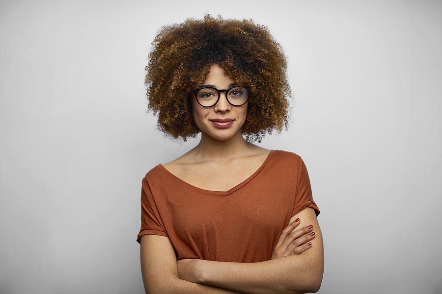 Smiling Young Female Afro Owner Against White Background Photograph by Morsa Images