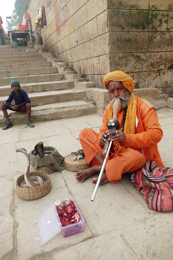 Snake charmer with his snakes by Steve Estvanik