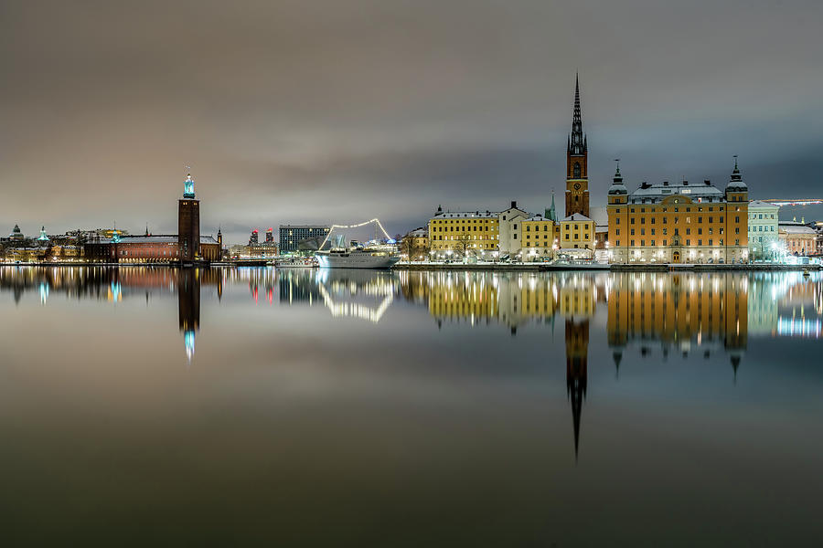 Stockholm Photograph - Snowy Stockholm City Hall and Riddarholmen reflection with clouds by Dejan Kostic