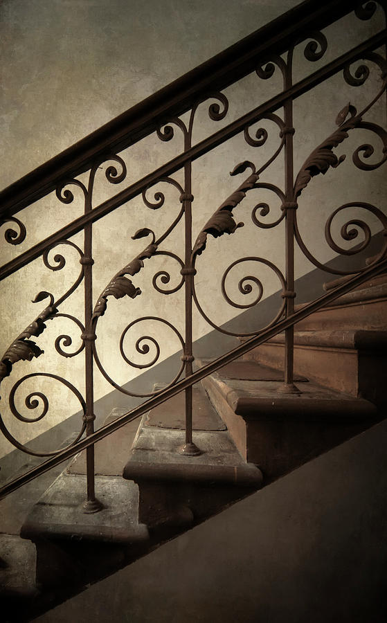 Staircase with iron ornamented handrail by Jaroslaw Blaminsky