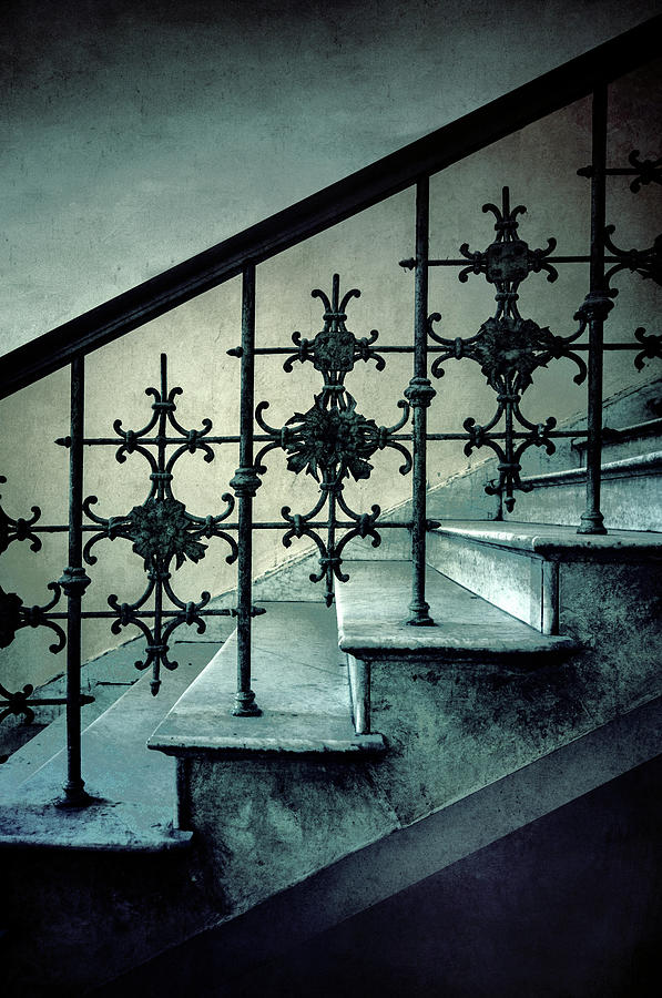 Stairs with pretty ornamented handrail by Jaroslaw Blaminsky