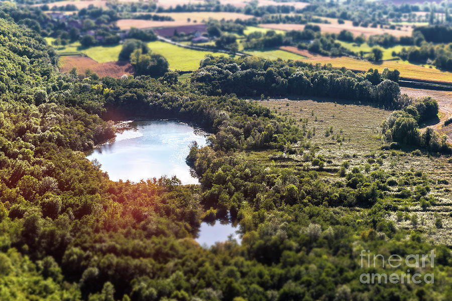 Standing water pond in french marsh aerial view landscape by Gregory DUBUS