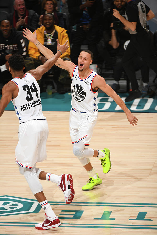 Stephen Curry and Giannis Antetokounmpo Photograph by Garrett Ellwood