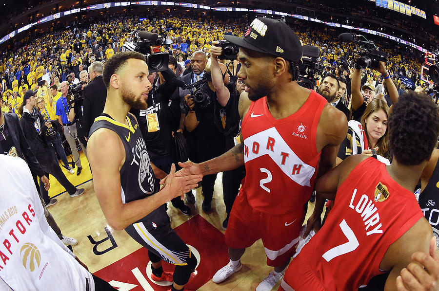 Stephen Curry and Kawhi Leonard Photograph by Andrew D. Bernstein