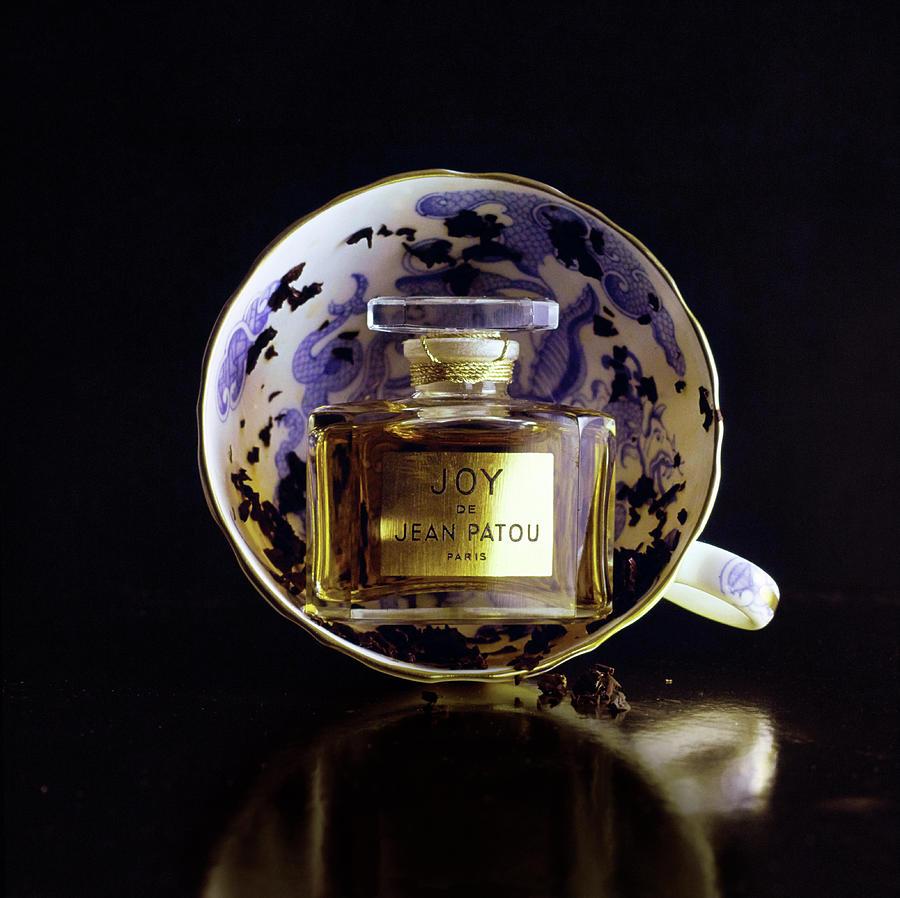 Still Life Of Patous Joy Perfume Photograph by Fotiades