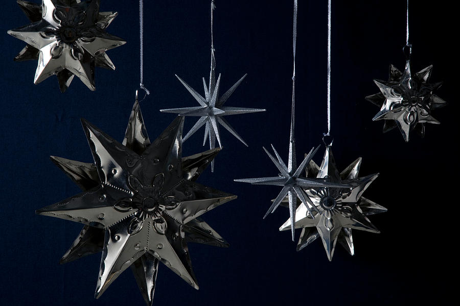 Still Life of Silver Star Ornaments Photograph by Romulo Yanes
