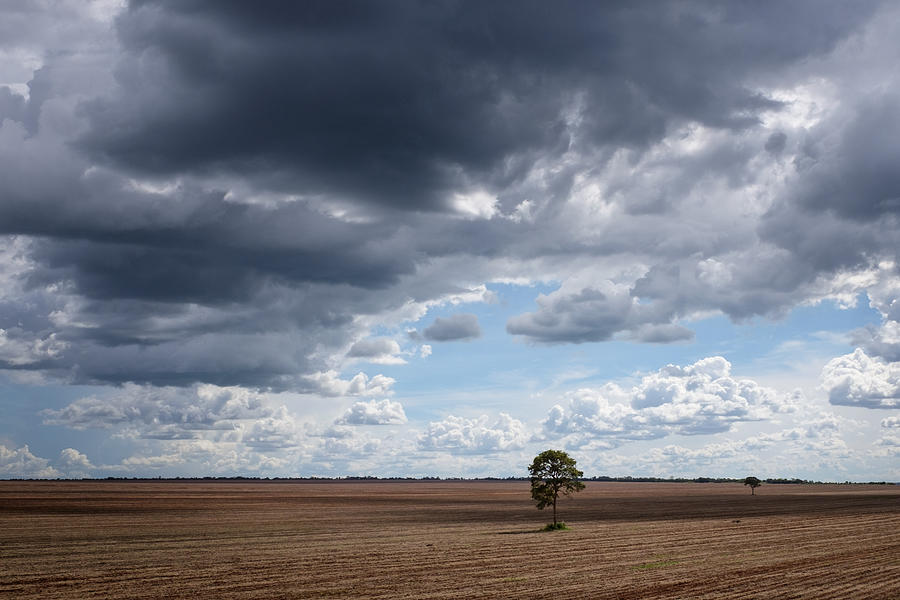 Storm Clouds Over Landscape Against Cloudy Sky Photograph by Matthias Gaberthüel / EyeEm