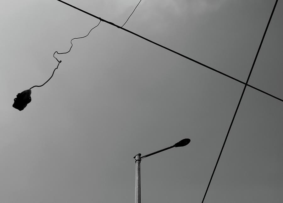 Street Lamp Photograph - Street Lamp and the Hanging Stone by Prakash Ghai
