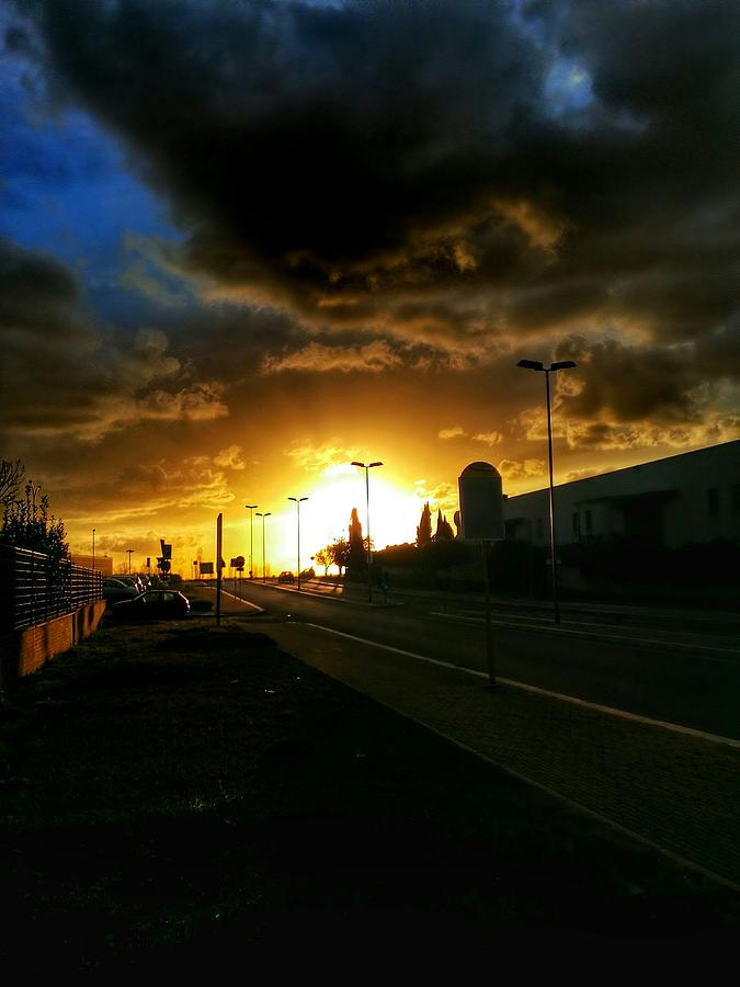 Street Lights On Road Against Cloudy Sky During Sunset Photograph by Massimiliano Pozzani / EyeEm