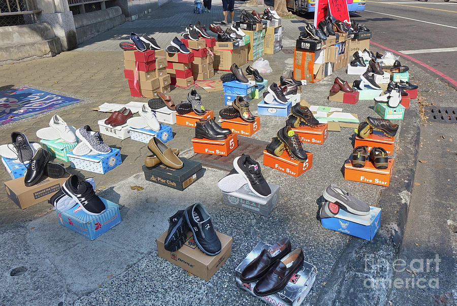 Street Vendor Sells New Shoes by Yali Shi