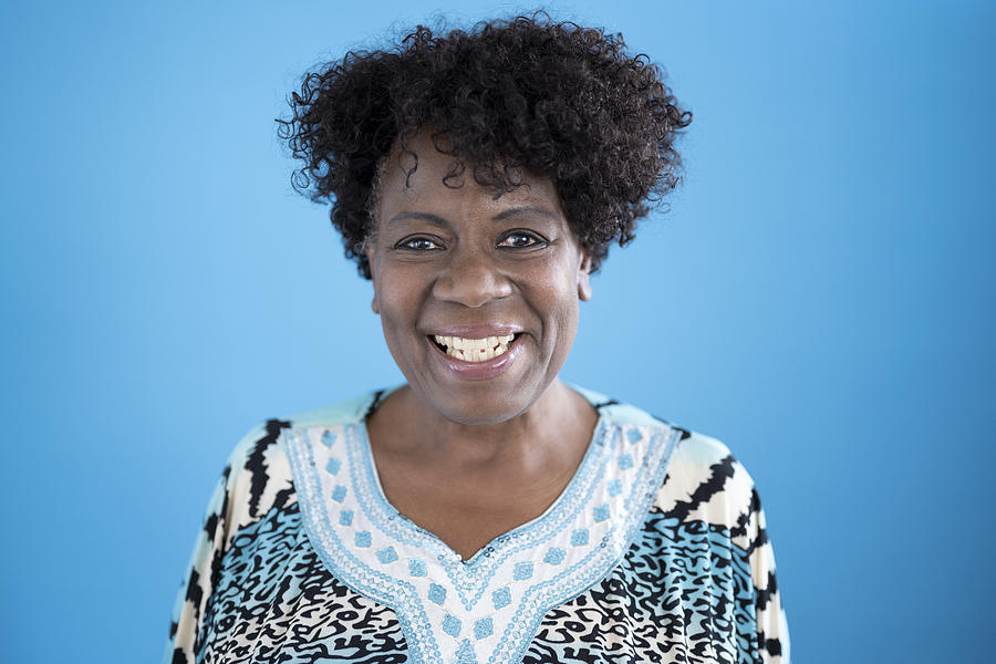 Studio portrait of 64 year old black woman smiling at camera Photograph by JohnnyGreig