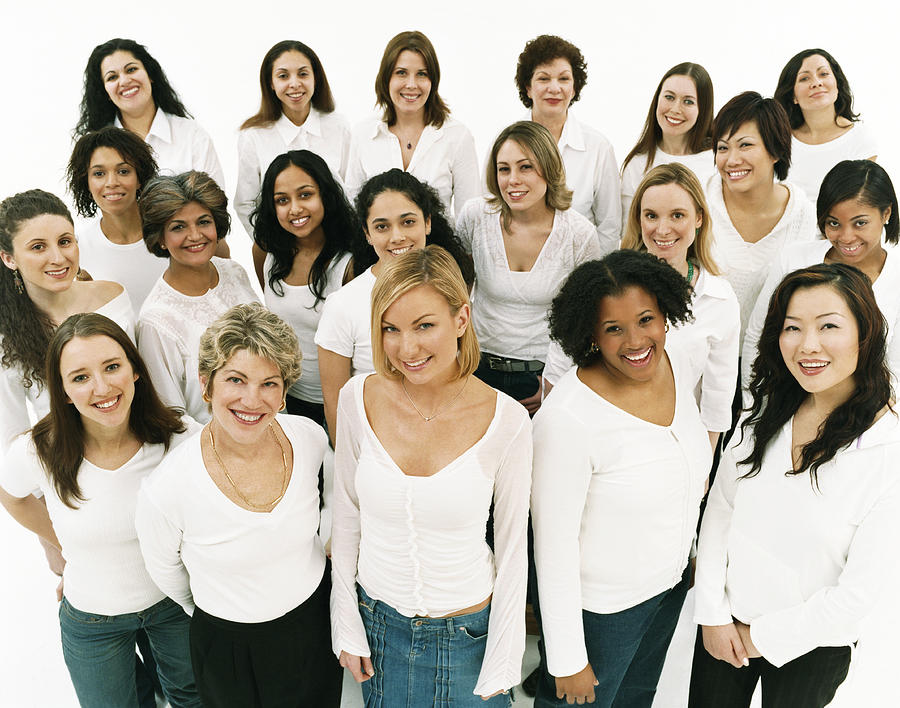 Studio Portrait of a Mixed Age, Multiethnic, Large Group of Happy Women Wearing White Tops Photograph by Digital Vision.