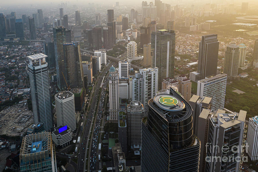 Stunning sunset over Jakarta business district in Indonesia capi by Didier Marti