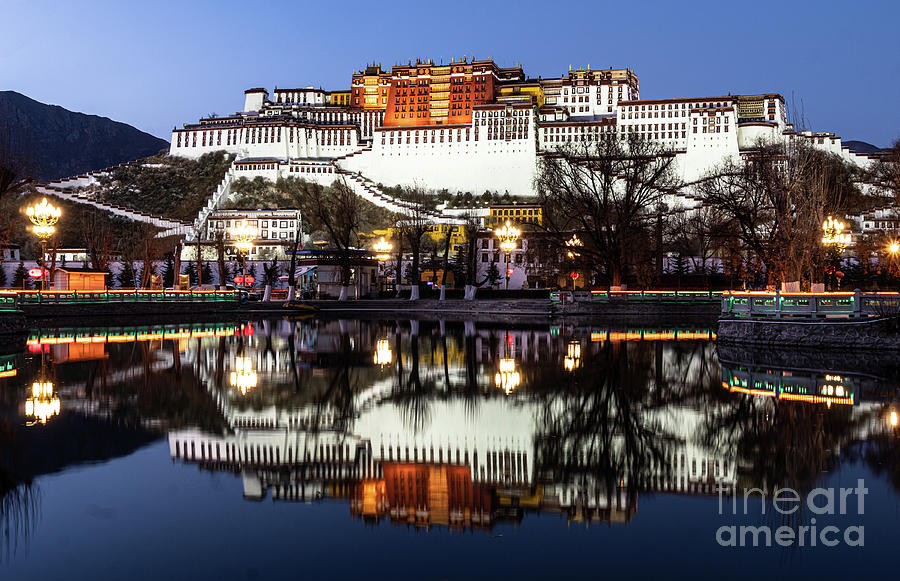 Stunning twilight over the famous Potala Palace in Lhasa old tow by Didier Marti