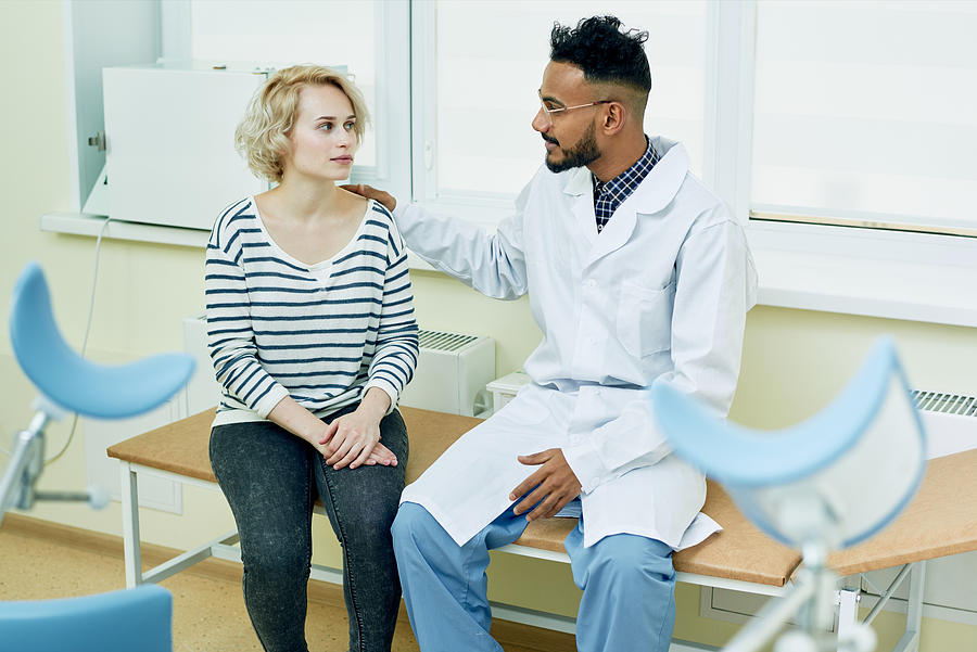 Successful Gynecologist Giving Advice To Patient Photograph by Mediaphotos
