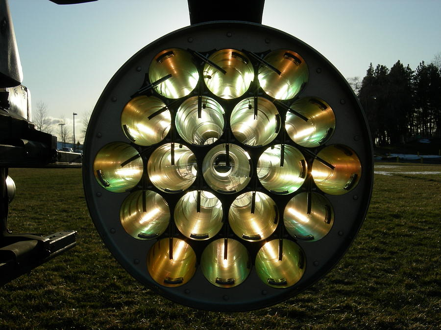 Sun through rocket launcher  by Jean Evans