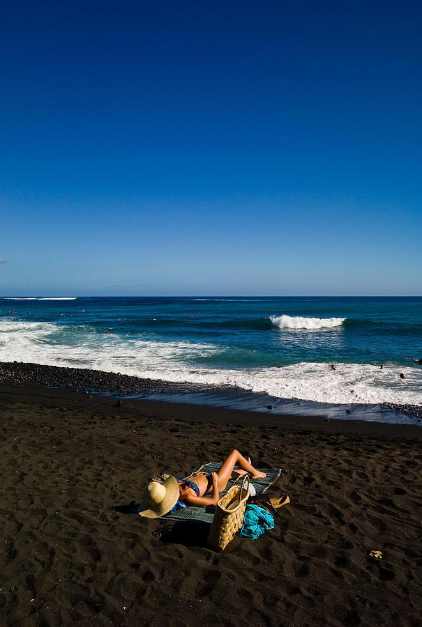 Sunbath on the black sand beach Photograph by Max shen
