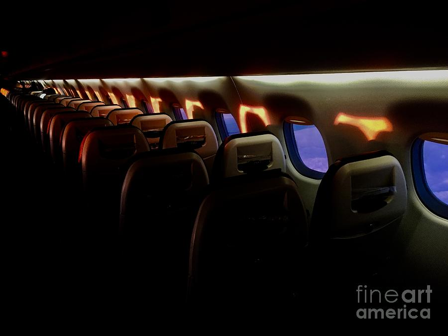 Sunrise in the sky - inside of an aircraft by Thomas Schroeder