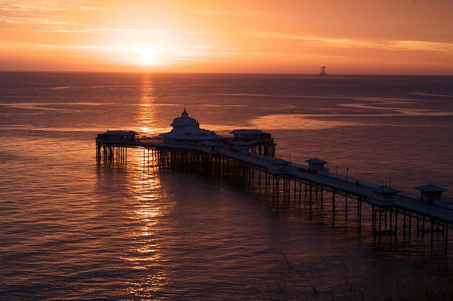 Piers Photograph - Sunrise over Llandudno pier 2 by Christopher Rowlands