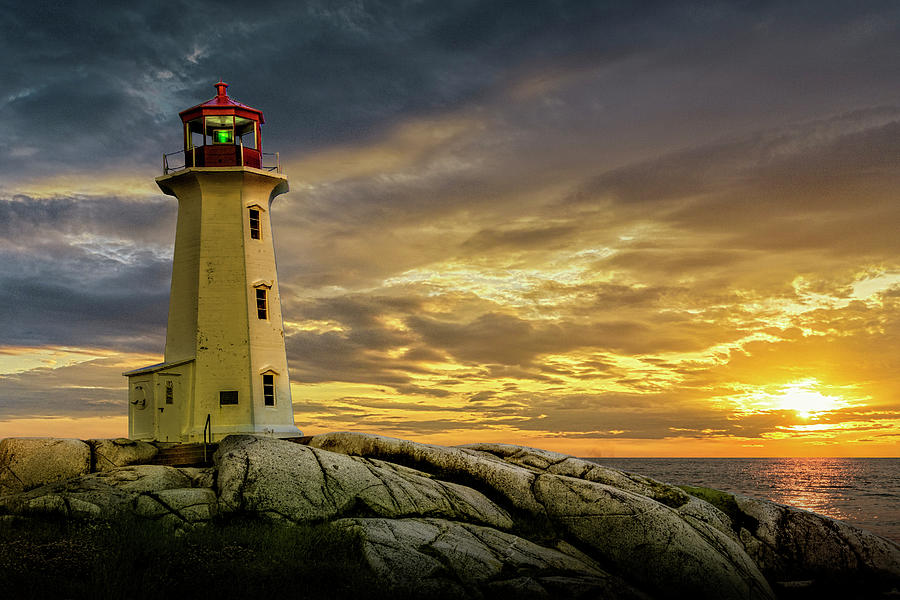 Sunset At Peggys Cove Lighthouse In Nova Scotia Photograph