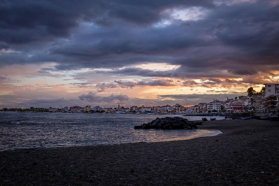 Sunset over Giardini Naxos, Ocean to the left, city to the right Photograph by Finn Bjurvoll Hansen