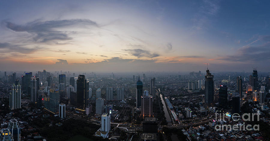 Sunset over Jakarta skyline business district in Indonesia by Didier Marti