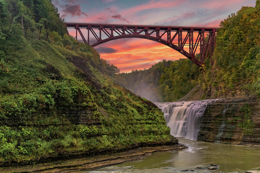 Sunset Over The Upper Falls And Arch Bridge At Letchworth State  by Jim Vallee