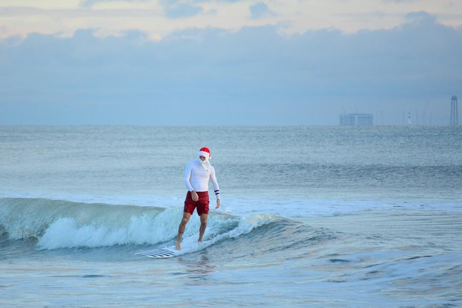 Surfing Santas 3 by Bradford Martin