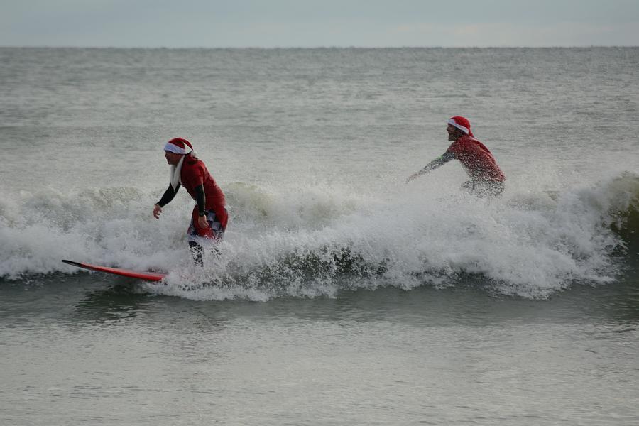 Surfing Santas 4 by Bradford Martin