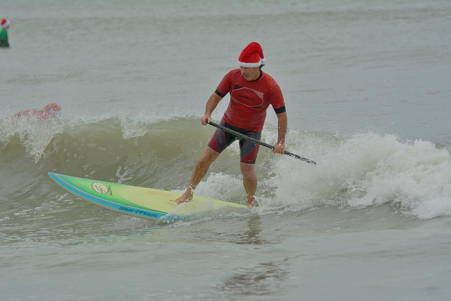 Surfing Santas 7  by Bradford Martin