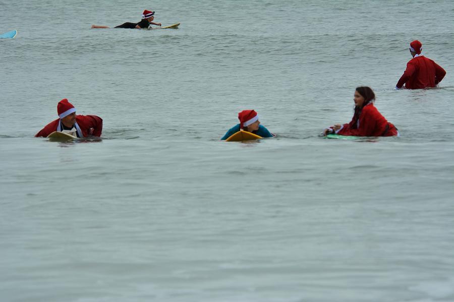 Surfing Santas 9 by Bradford Martin