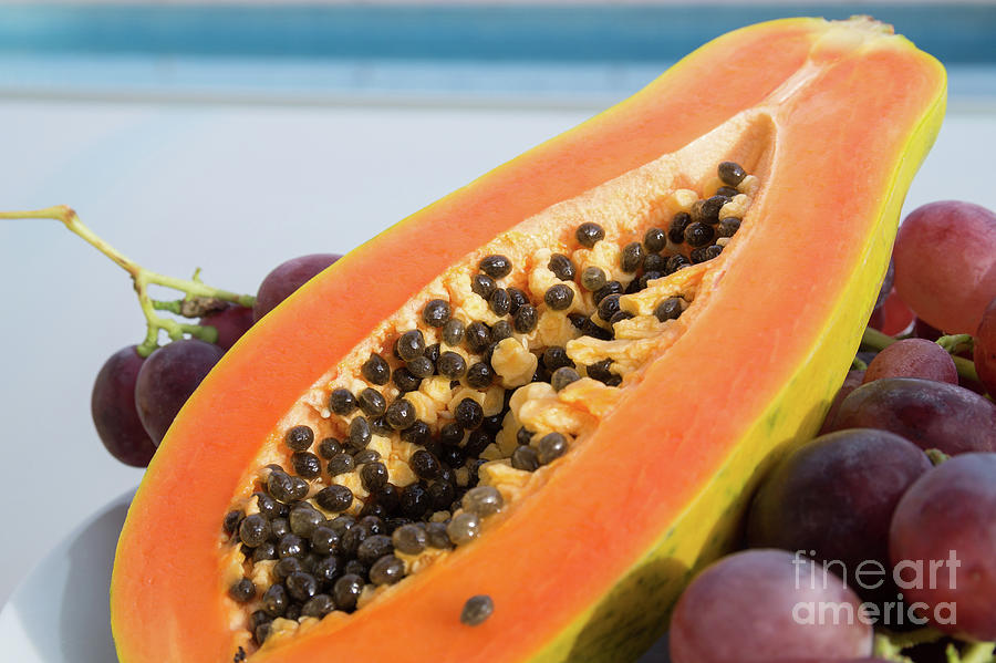 Sweet Taste Of Papaya And Red Grapes In The Sunlight Photograph