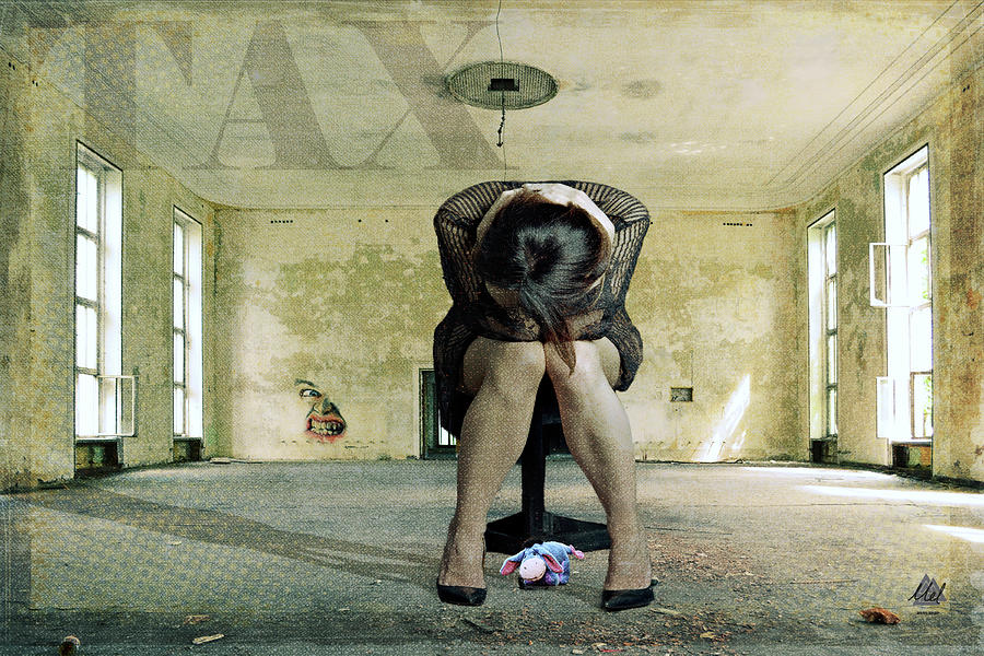 A Woman Sits Distraught In An Empty Room. Photograph