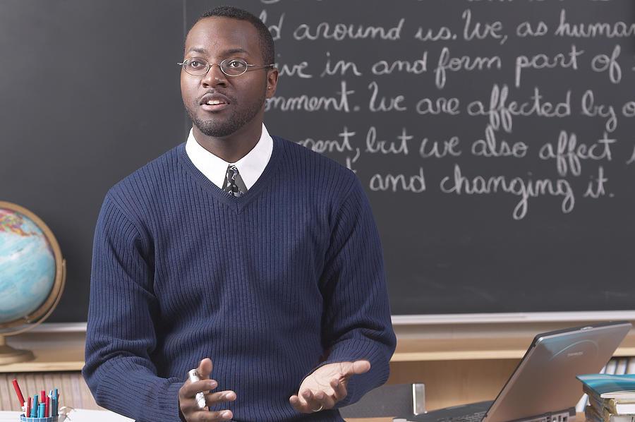 Teacher lecturing Photograph by Hemera Technologies