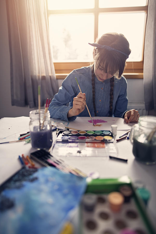 Teenage girl painting with watercolors Photograph by Imgorthand