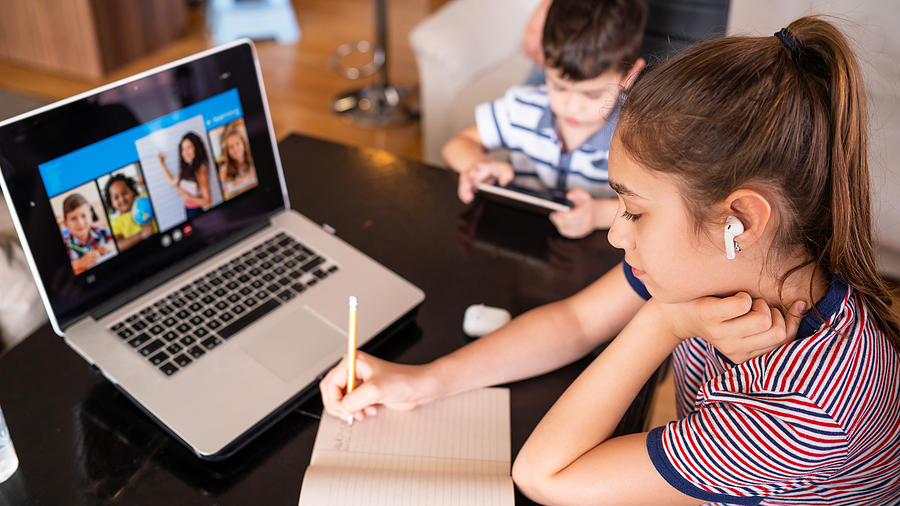 Teenage girl studying with video online lesson at home   family in isolation Homeschooling and distance learning Photograph by Valentinrussanov