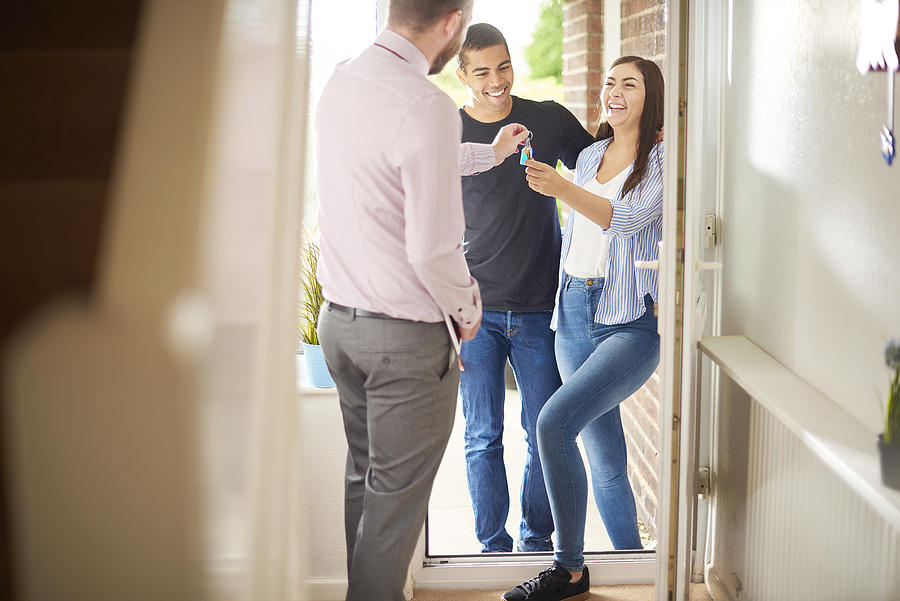 Tenants Receiving Their Property Keys Photograph by Sturti