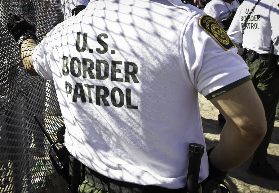 The Back of a United States Border Patrol Agent Photograph by VallarieE