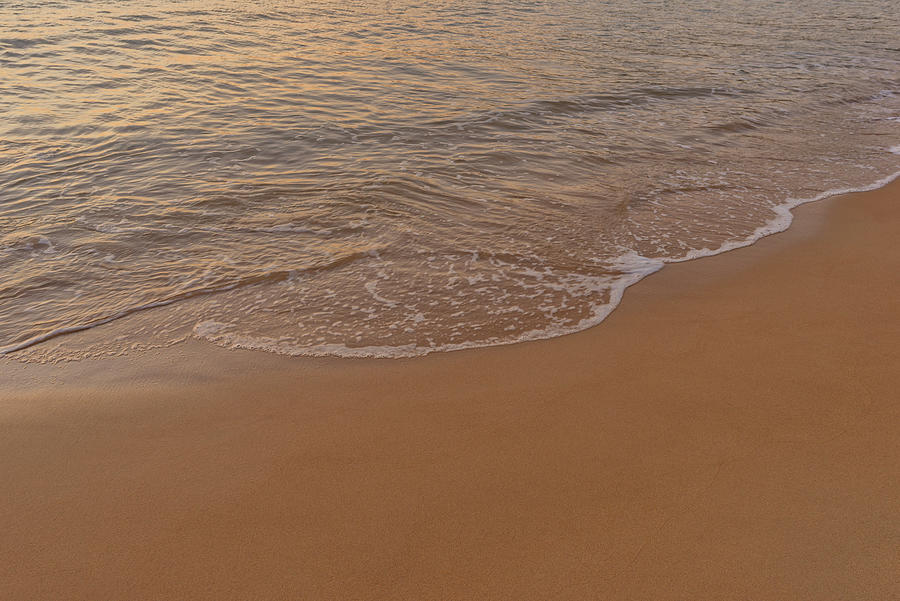 The calm sea on the shore of the beach by Vicen Photography